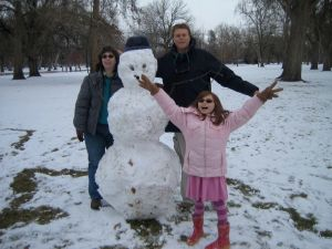 Our family with a snowman during a visit in Boise